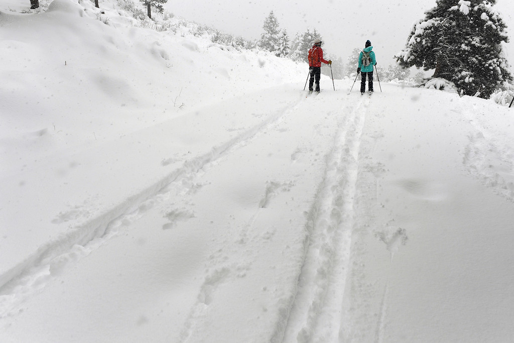 . Sara Born, left, and Kestrel Hanson Neathawk, get first tracks along Ridge Road as they enjoy the almost 2 feet of snow on April 16, 2016 in Nederland, Colorado. A spring storm dumped more than 2 feet of snow in the foothills and more is expected overnight.  (Photo by Helen H. Richardson/The Denver Post)