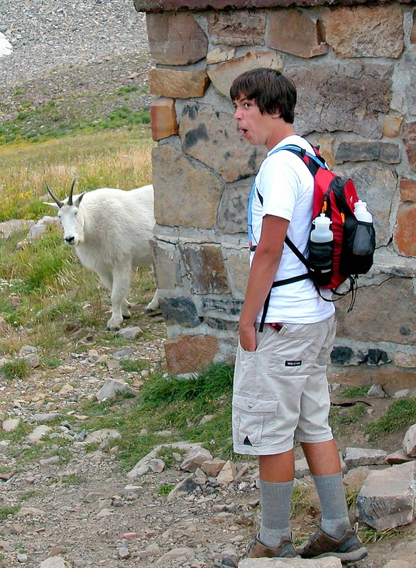 Long story short - I saw that my son Sean and the goat were going to meet at the corner of the stone building. Sean had no idea what was about to happen. I had just enough time to capture the expression on his face when they actually saw each other. The moment was priceless.