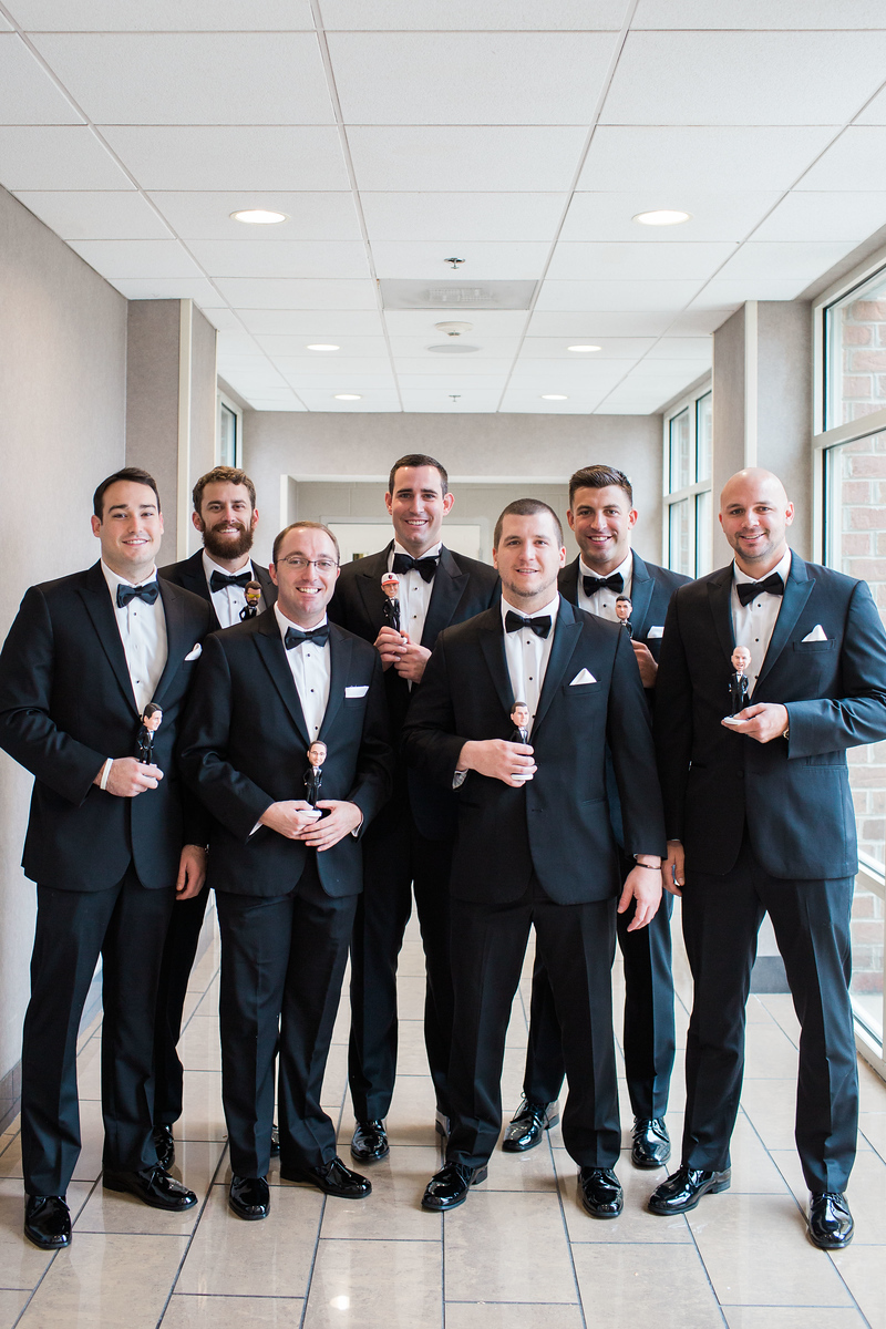 Kyle gave his groomsmen custom bobbleheads as his groomsmen gift for his Bluemont Vineyard wedding. Photos by the best Washington DC wedding photographer Jalapeno Photography. The Catholic wedding ceremony was at St. Theresa Catholic Church in Ashburn, VA.