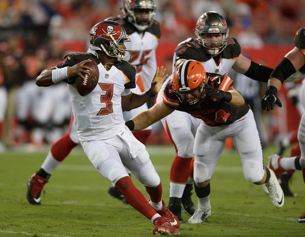 . Cleveland Browns defensive end Carl Nassib (94) chases Tampa Bay Buccaneers quarterback Jameis Winston during the second quarter of an NFL preseason football game Saturday, Aug. 26, 2017, in Tampa, Fla. (AP Photo/Jason Behnken)