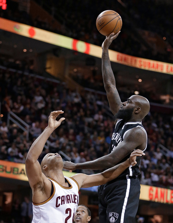 . Brooklyn Nets\' Quincy Acy, right, shoots over Cleveland Cavaliers\' Richard Jefferson during the first half of an NBA basketball game, Friday, Jan. 27, 2017, in Cleveland. (AP Photo/Tony Dejak)