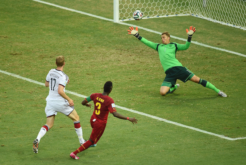 . Ghana\'s forward and captain Asamoah Gyan (C) scores during a Group G football match between Germany and Ghana at the Castelao Stadium in Fortaleza during the 2014 FIFA World Cup on June 21, 2014. (EMMANUEL DUNAND/AFP/Getty Images)