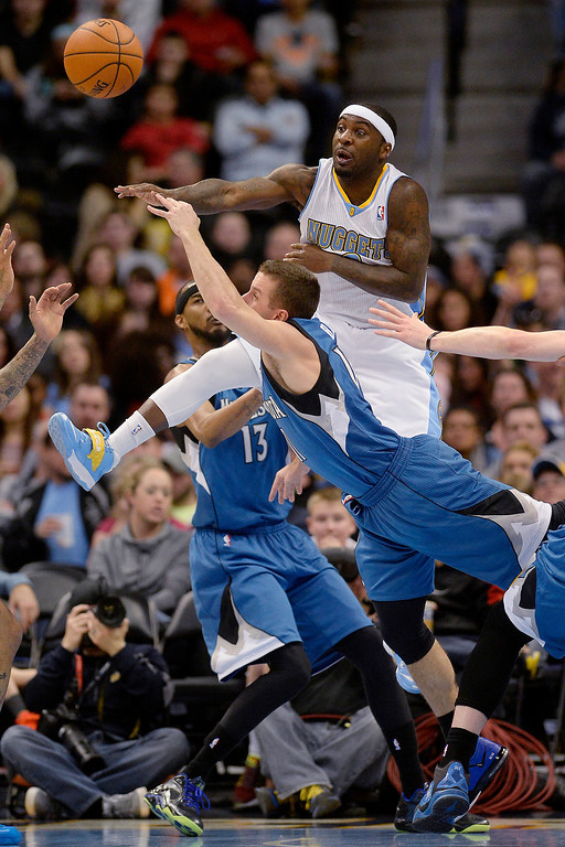 . Ty Lawson (3) of the Denver Nuggets defends J.J. Barea (11) of the Minnesota Timberwolves during the first quarter at the Pepsi Center on Monday, March 3, 2014. (Photo By AAron Ontiveroz/The Denver Post)
