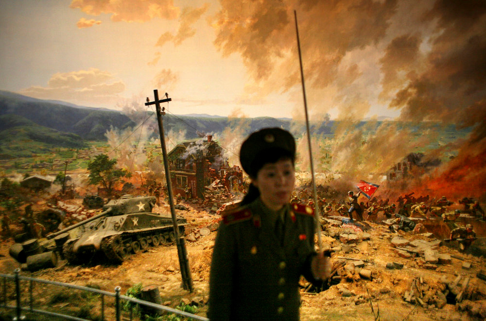 Description of . A guide gives a lecture in front of a diorama showing the Korean War's 1950 battle of Taejon as she gives a tour of the War Museum in Pyongyang, North Korea on Tuesday Sept. 16, 2008.  (AP Photo/David Guttenfelder)