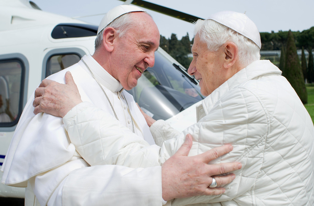". ""Pope emeritus\"" Benedict XVI (R) greets Pope Francis upon his arrival at the heliport in Castel Gandolfo on March 23, 2013. Pope Francis prepared to go face to face with his predecessor Benedict XVI in a historic meeting between two men with very different styles but important core similarities.   OSSERVATORE ROMANO/AFP/Getty Images"