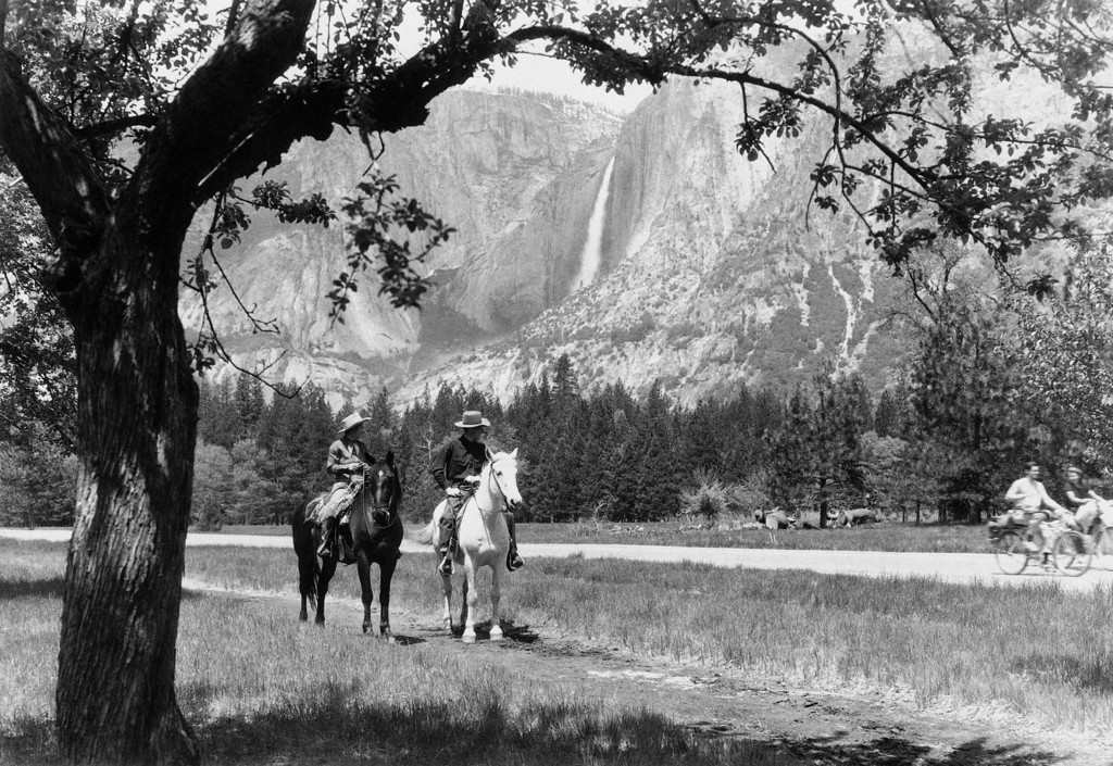 . Horseback riders and cyclists ride amid the spacious beauty of Yosemite National Park in California, June 4, 1944. (AP Photo)