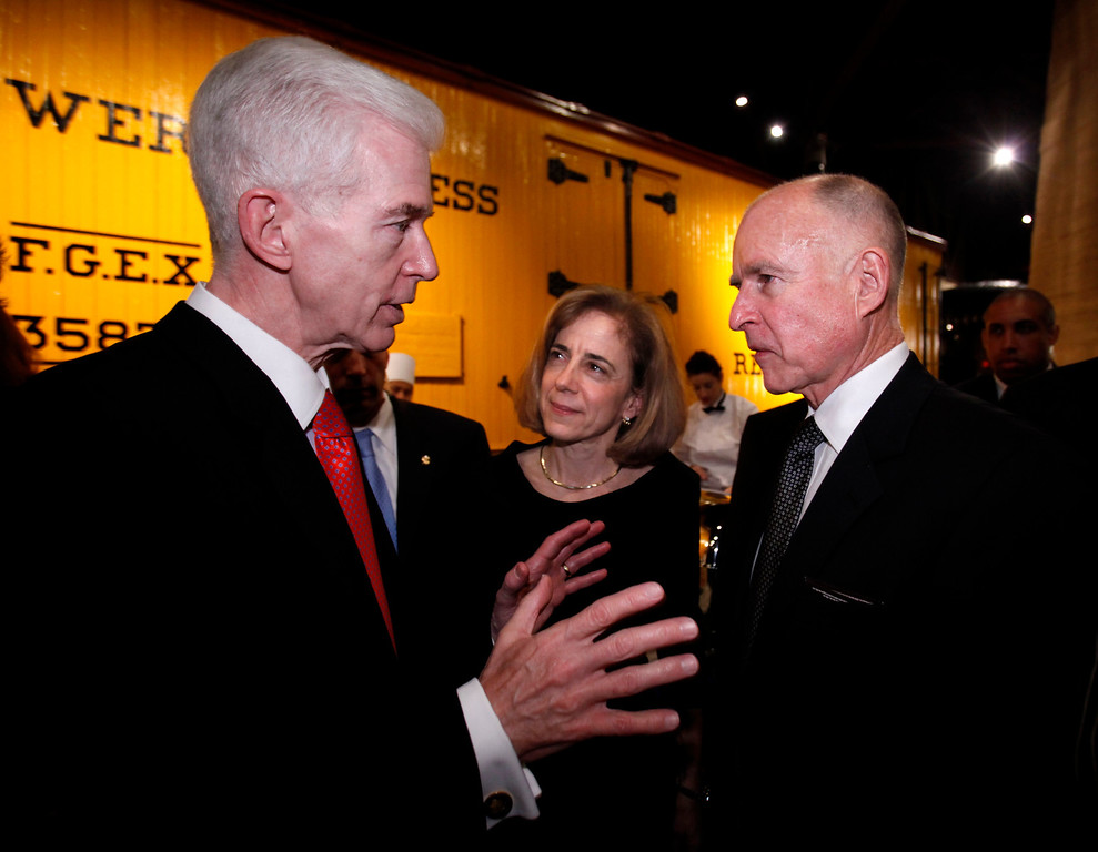 . Former Gov. Gray Davis, left, talks with newly sworn-in Gov. Jerry Brown, as Brown\'s wife, Anne Gust Brown, center, looks on during a reception held for Brown at the California Railroad Museum in Sacramento, Calif., Monday, Jan. 3, 2011. Davis served as Brown\'s chief of staff during Brown\'s first tenure as California\'s Governor in the 1970\'s. (AP Photo/Rich Pedroncelli)