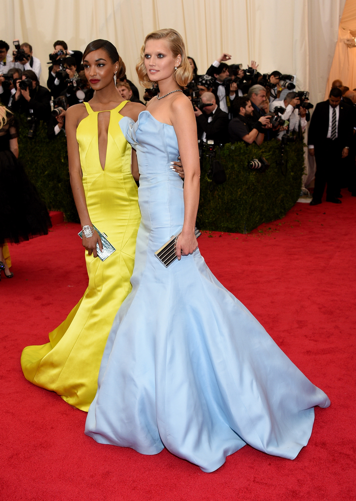 """. Jourdan Dunn (L) and Toni Garrn attend the \""""Charles James: Beyond Fashion\"""" Costume Institute Gala at the Metropolitan Museum of Art on May 5, 2014 in New York City.  (Photo by Larry Busacca/Getty Images)"""