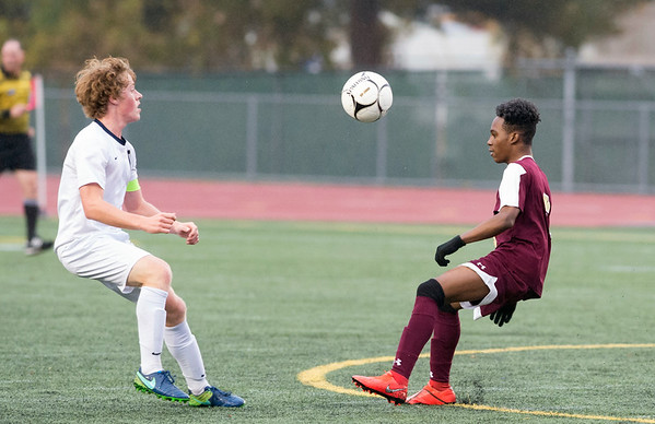 10/29/19 Wesley Bunnell | StaffrrNew Britain soccer was defeated 2-0 by Newington during a drizzle at Veterans Stadium on Tuesday afternoon. Newington's Ryan Saindon (11) and New Britain's Andwel Salmon (6).