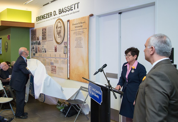 03/20/19 Wesley Bunnell | Staff CCSU held the Ebenezer D. Bassett Hall among ceremony on Wednesday night honoring the first African American graduate from the school. President Zulma Toro, 2nd R, was speaking when the covering over the wall dedicated to Ebenezer D. Bassett came down on its own with an early reveal.