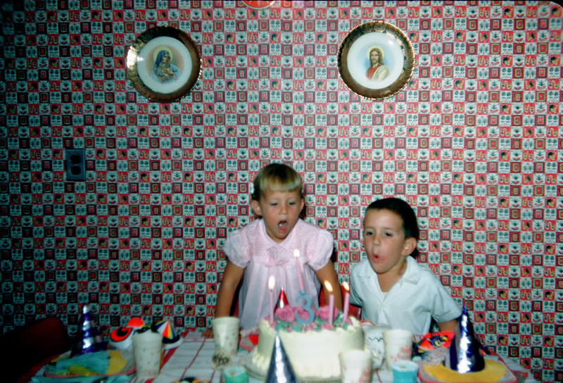 susan's 3rd birthday with richard blowing candles.jpg