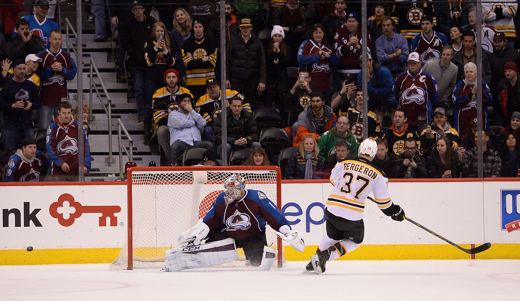 . DENVER, CO - JANUARY 21: Colorado Avalanche goalie Semyon Varlamov (1) makes a save on a shot by Boston Bruins center Patrice Bergeron (37) in the shoot out January 21, 2015 at Pepsi Center. Colorado Avalanche defeated the Boston Bruins 3-2 in a shoot out. (Photo By John Leyba/The Denver Post)