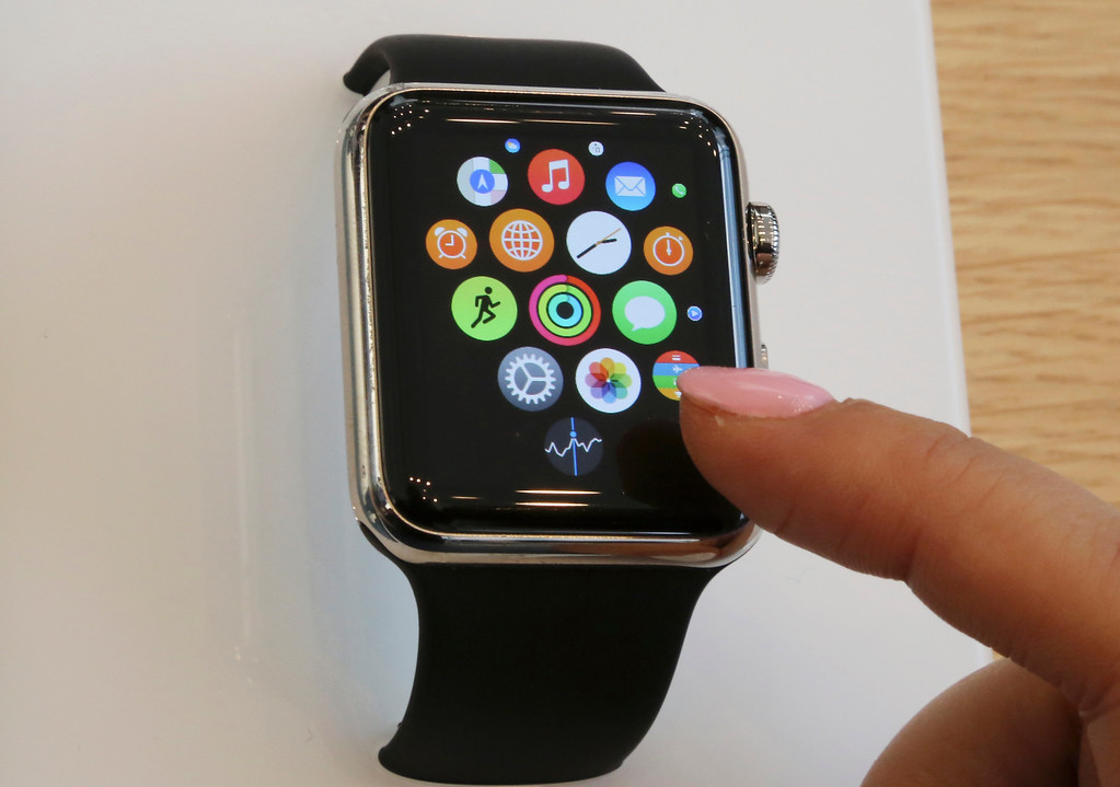 . A customer demonstrates Apple Watch at an Apple Store in Tokyo as Apple Watch made its debut Friday, April 10, 2015. Customers were invited to try them on in stores and order them online. (AP Photo/Koji Sasahara)