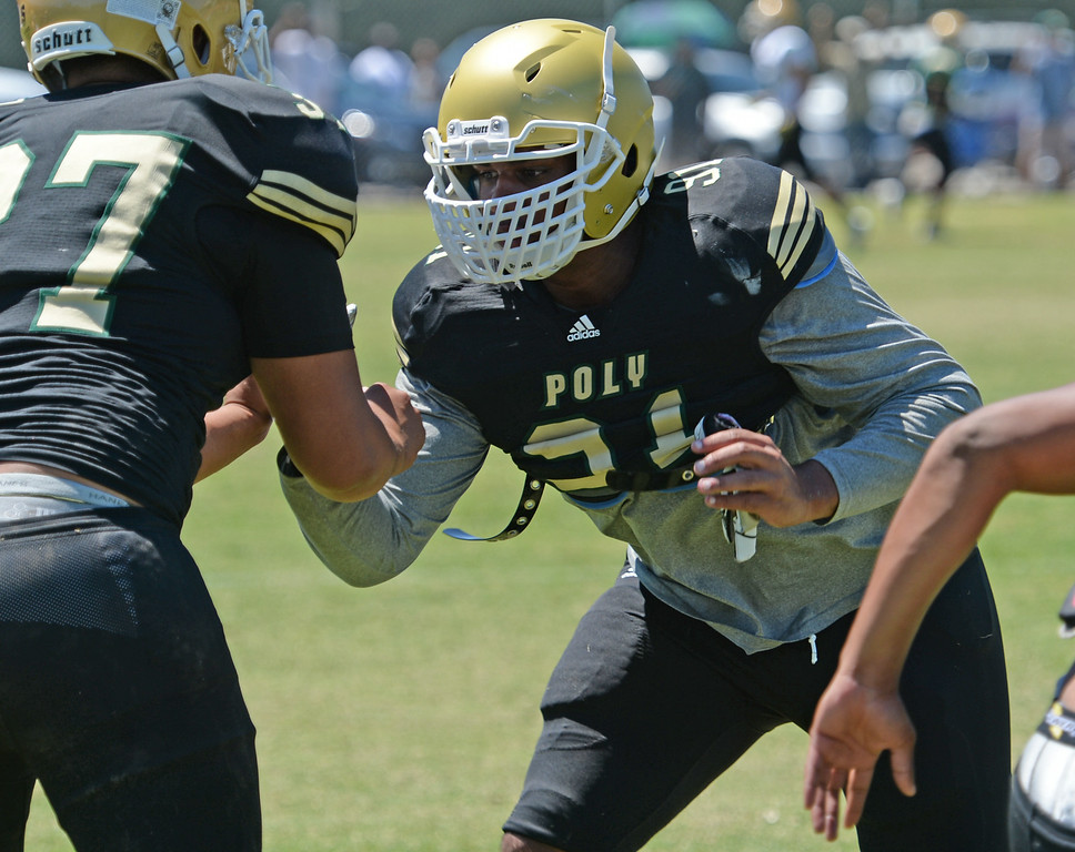 . All-American Joseph Wicker, right, during Long Beach Poly football practice Saturday, August 16, 2014, Long Beach, CA.   Photo by Steve McCrank/Daily Breeze