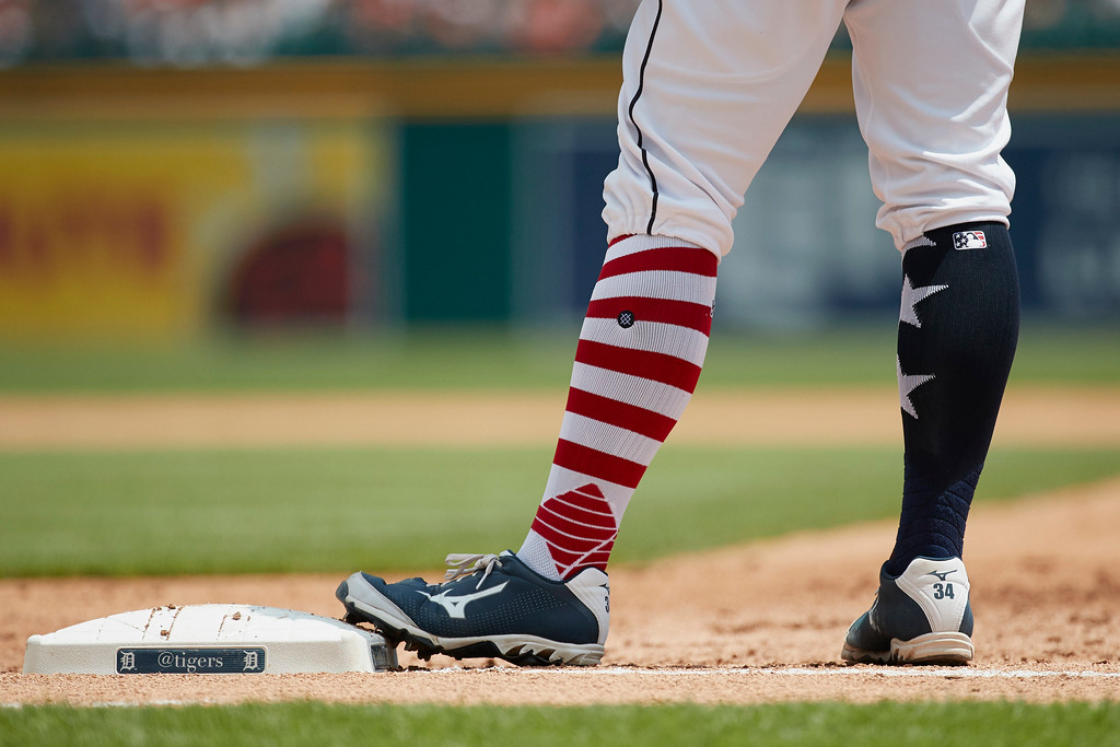 . Detroit Tigers catcher James McCann (34) stands on first base wearing sock for Independence Day weekend during the second inning against the Cleveland Indians in the first baseball game of a doubleheader in Detroit, Saturday, July 1, 2017. (AP Photo/Rick Osentoski)