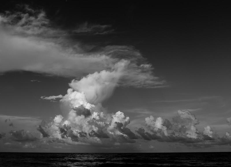 b+w beach clouds