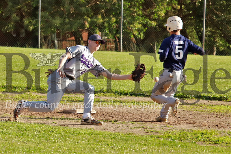 Karns City's #2 stretches out to try to catch Saxonburg's #5 stealing. Seb Foltz/Butler Eagle