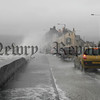 The high tide and strong winds threw up big waves as they  batter the front shore on the Rostrevor road Warrenpoint, 07W10N68