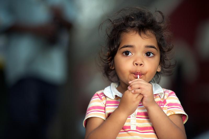 Indigenous Australian Girl sucking a lollipop