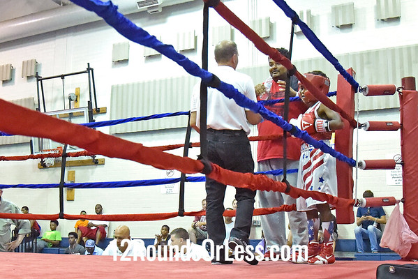Bout 10 = Main Event, Christopher Simmons, Red Gloves, 11 Yrs, 70 lbs, NC -vs- Travell Goo Fain, Blue Gloves, 11 yrs, 70 lbs, Akron