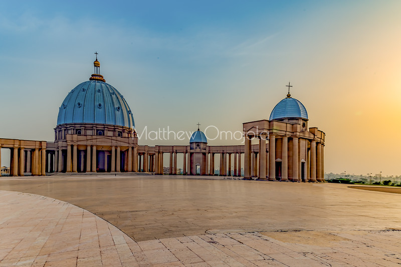 East end, with the setting sun, of the Basilica of Our Lady of Peace Basilique Notre Dame de la Paix Yamoussoukro Ivory Coast Cote d'Ivoire West Africa. The largest church in the world.