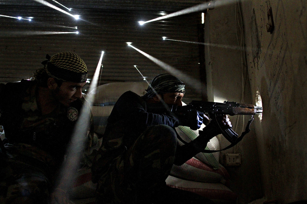 . World Press Photo 3rd prize stories Spot News, Javier Manzano.   Two Syrian rebels take sniper positions at the heavily contested neighborhood of Karmal Jabl in central Aleppo on October 18, 2012. Violence persisted on October 19 with rebels and loyalists of President Bashar al-Assad locked in battle for the northwestern town of Maaret al-Numan on the Damascus-Aleppo highway linking Syria\'s two biggest cities. AFP PHOTO/JAVIER Manzano/AFP/Getty Images