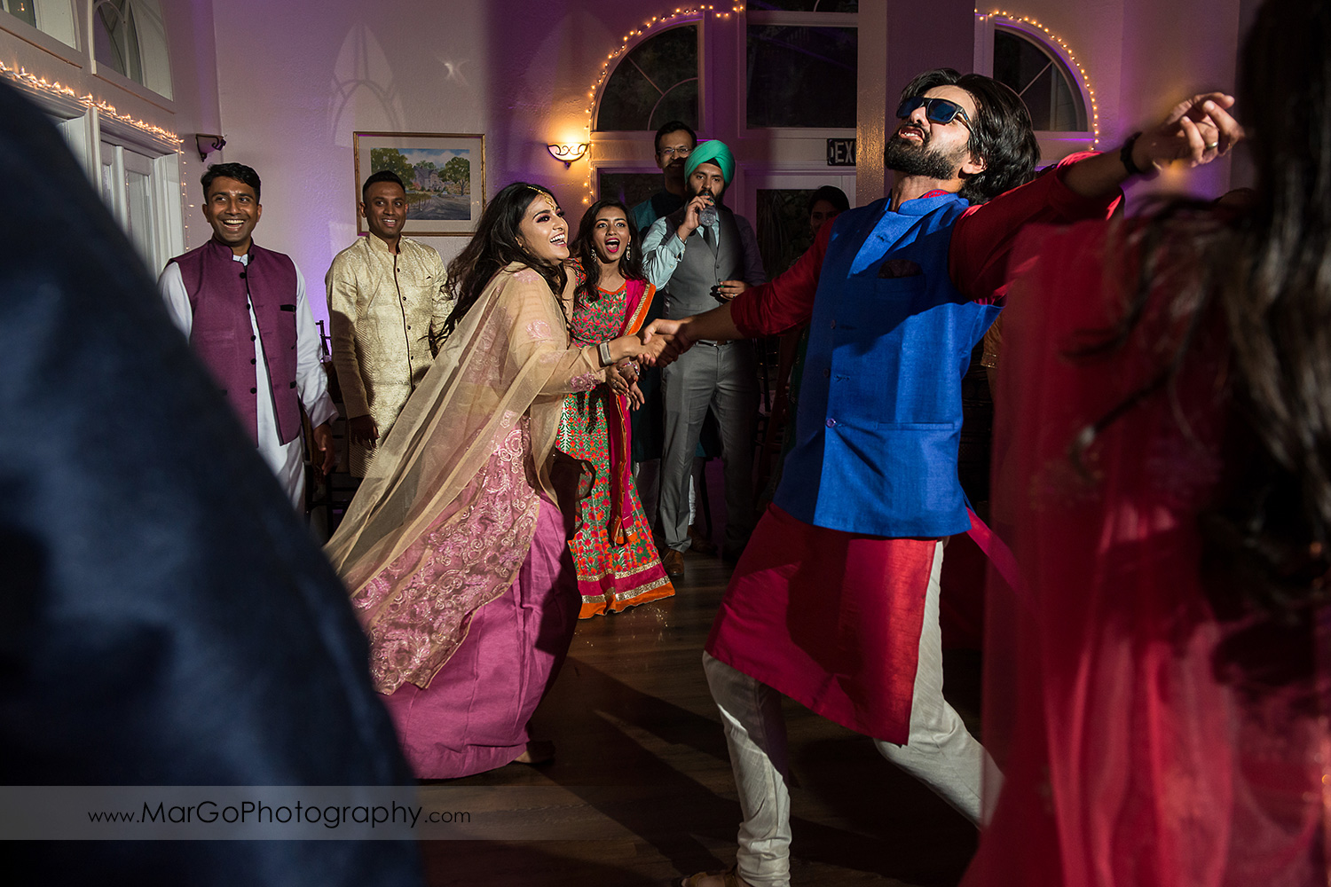 guest dancing durng Indian wedding reception at Elliston Vineyards in Sunol