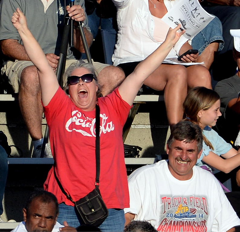 . Fans react during the high jump during the CIF-SS Masters Track and Field meet at Falcon Field on the campus of Cerritos College in Norwalk, Calif., on Friday, May 30, 2014.   (Keith Birmingham/Pasadena Star-News)