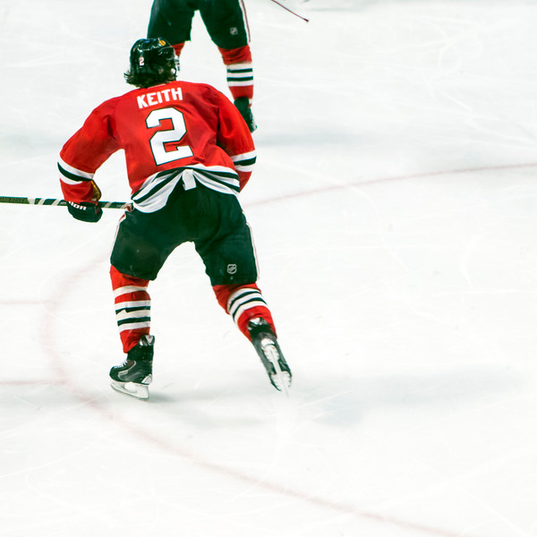 Duncan Keith skating out of the zone.