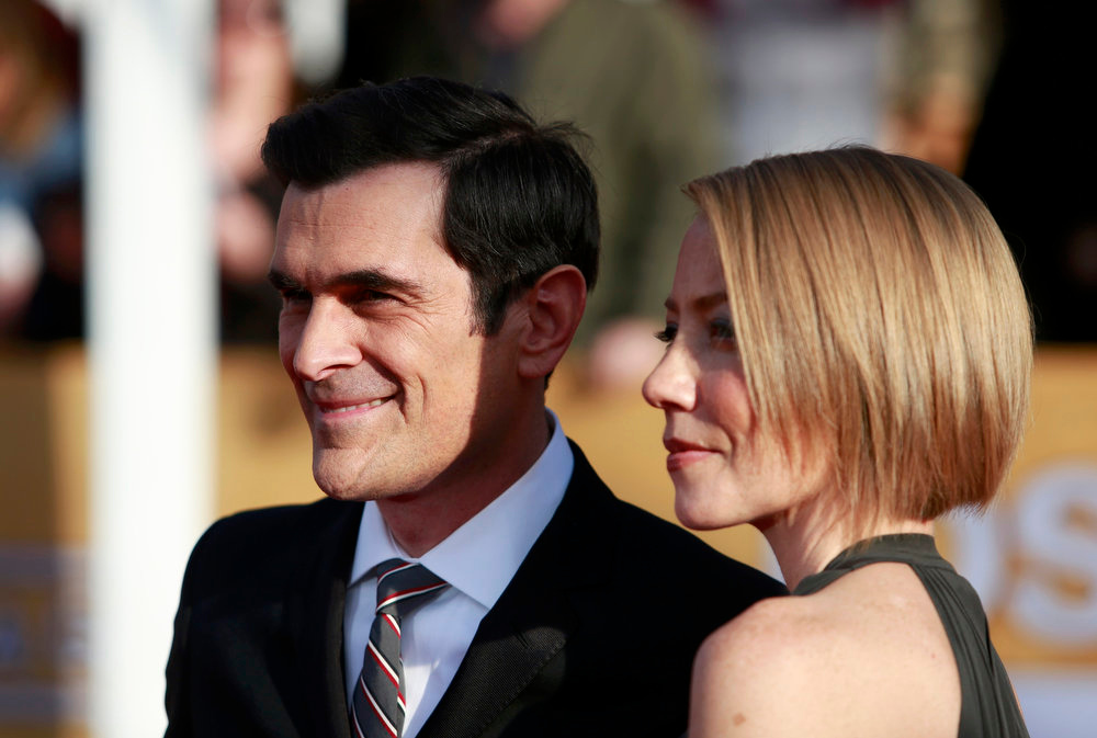 ". Actor Ty Burrell, of the television comedy ""Modern Family\"" and his wife Holly Anne Brown arrive at the 19th annual Screen Actors Guild Awards in Los Angeles, California January 27, 2013.  REUTERS/Adrees Latif"