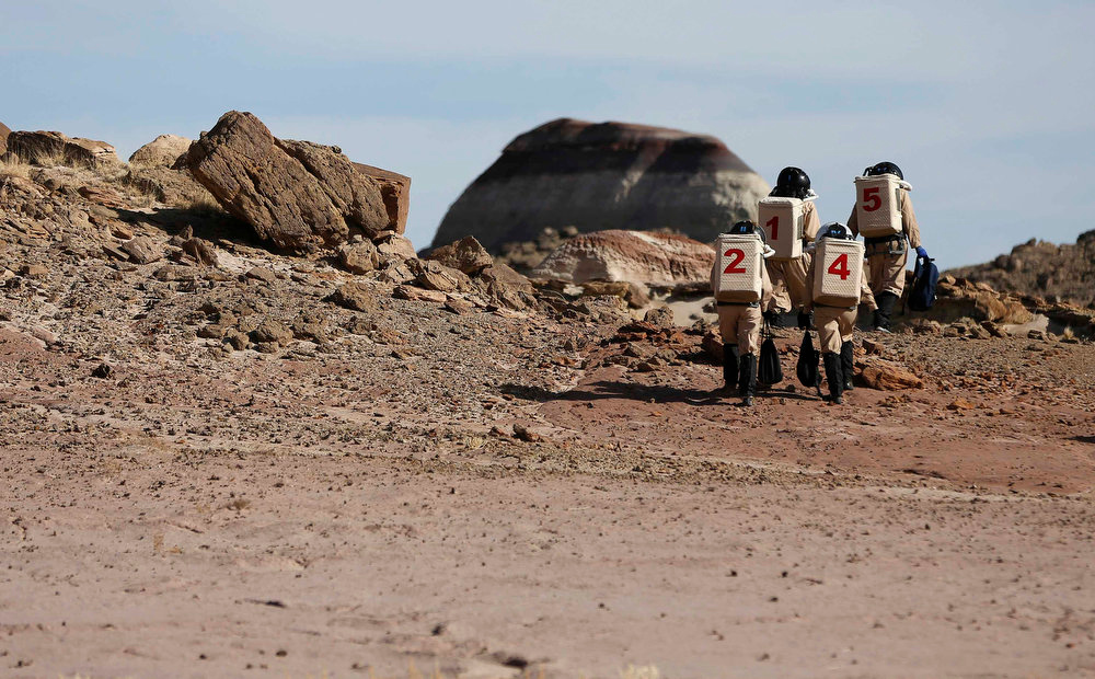 Description of . Members of Crew 125 EuroMoonMars B mission venture out in their simulated spacesuits to collect geologic samples for study at the Mars Desert Research Station (MDRS) in the Utah desert March 2, 2013.  REUTERS/Jim Urquhart