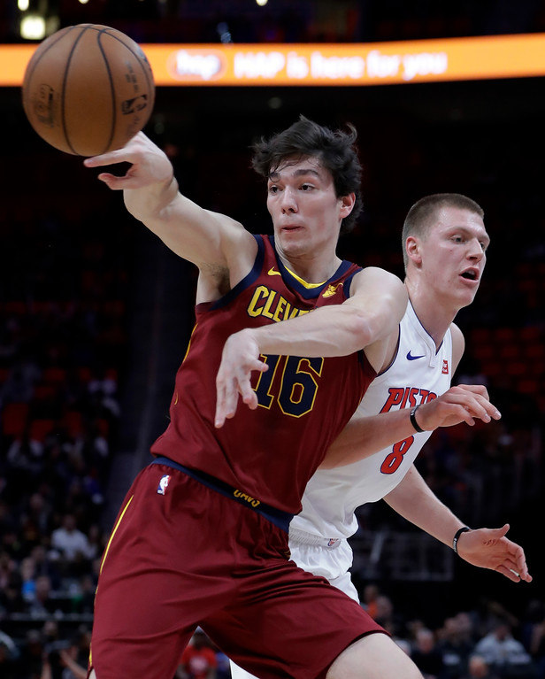 . Cleveland Cavaliers forward Cedi Osman (16) passes the ball after running into Detroit Pistons forward Henry Ellenson during the second half of an NBA basketball game, Monday, Nov. 20, 2017, in Detroit. (AP Photo/Carlos Osorio)