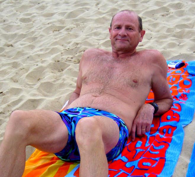 Tony's towel underneath Tony at Mosselbay Beach, South Africa