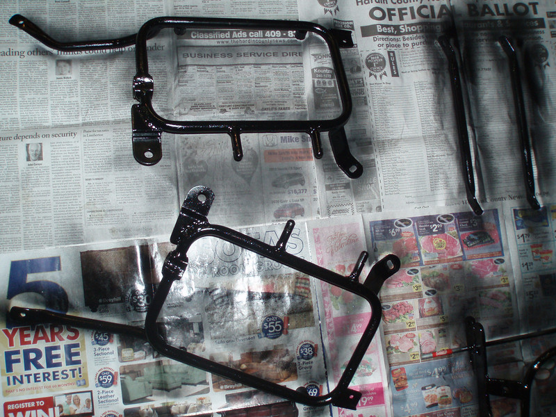 Side case mounting brackets modified to fit the Bandit get a fresh coat of paint.