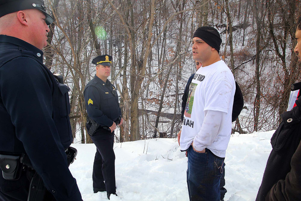 . Jose Oliver the father of the missing Fitchburg boy Jeremiah Oliver, 5, talks to police officer Joshua Lambert and Lt Jeff Howe as they searched for Jeremiah on Saturday in Fitchburg. SENTINEL & ENTERPRISE/JOHN LOVE