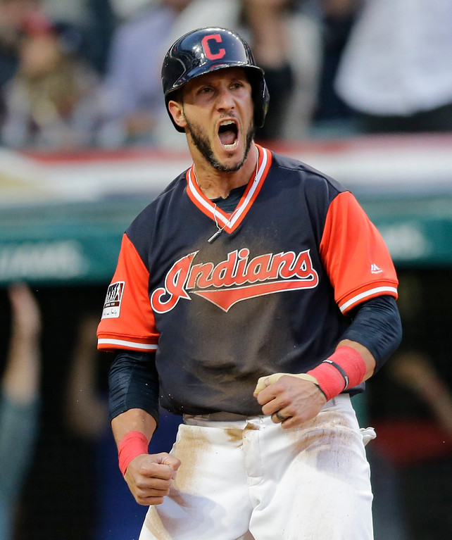 . Cleveland Indians\' Yan Gomes reacts after scoring against the Kansas City Royals during the third inning of a baseball game, Friday, Aug. 25, 2017, in Cleveland. (AP Photo/Tony Dejak)