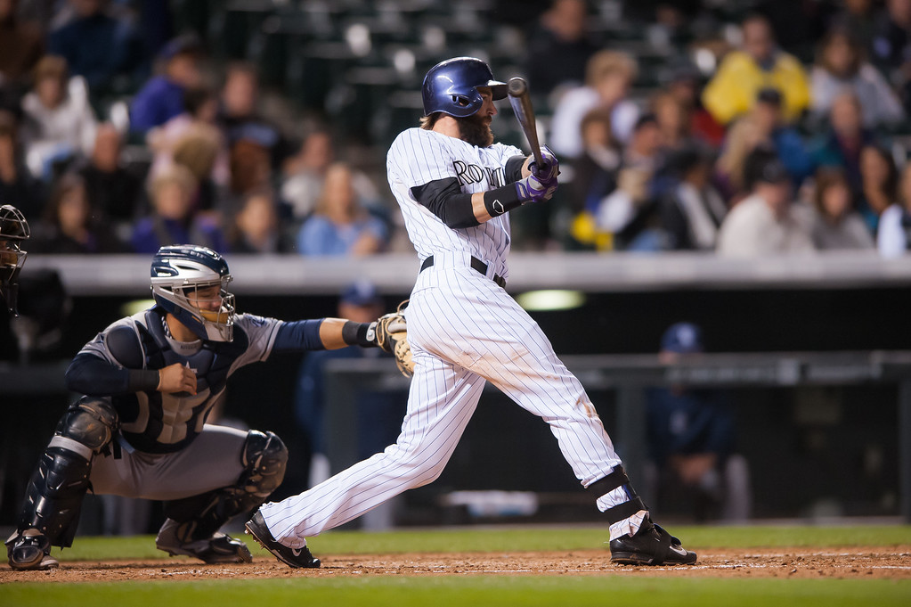 . DENVER, CO - SEPTEMBER 05:  Charlie Blackmon #19 of the Colorado Rockies hits a fifth inning RBI single against the San Diego Padres during a game at Coors Field on September 5, 2014 in Denver, Colorado.  (Photo by Dustin Bradford/Getty Images)