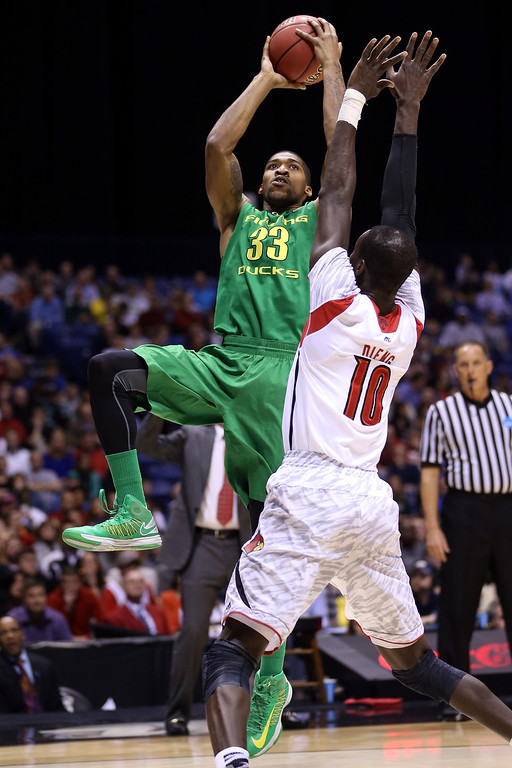 . Carlos Emory #33 of the Oregon Ducks drives for a shot attempt in the first half against Gorgui Dieng #10 of the Louisville Cardinals during the Midwest Region Semifinal round of the 2013 NCAA Men\'s Basketball Tournament at Lucas Oil Stadium on March 29, 2013 in Indianapolis, Indiana.  (Photo by Streeter Lecka/Getty Images)