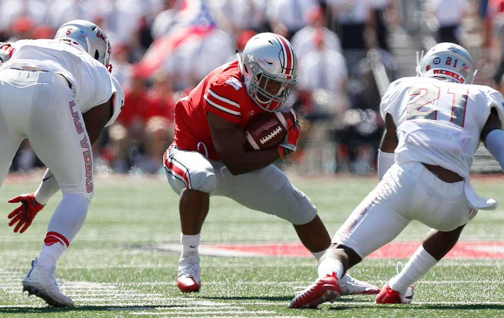 . Ohio State running back J.K. Dobbins cuts back up field between UNLV defenders during the first half of an NCAA college football game Saturday, Sept. 23, 2017, in Columbus, Ohio. Ohio State beat UNLV 54-21. (AP Photo/Jay LaPrete)