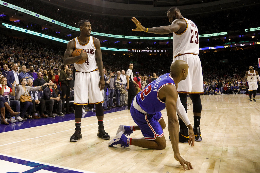 . Cleveland Cavaliers\' Iman Shumpert, left, holds onto the ball as LeBron James, right, signals after knocking the ball away from Philadelphia 76ers\' Gerald Henderson, center, on the final shot during the second half of an NBA basketball game, Saturday, Nov. 5, 2016, in Philadelphia. The Cavaliers won 102-101. (AP Photo/Chris Szagola)