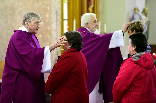 3/6/2019 Mike Orazzi | Staff St Stanislaus Roman Catholic Church Deacon Richard J. Wisniewski and Rev. Tomasz Sztuber apply ashes during Ash Wednesday Mass in Bristol.