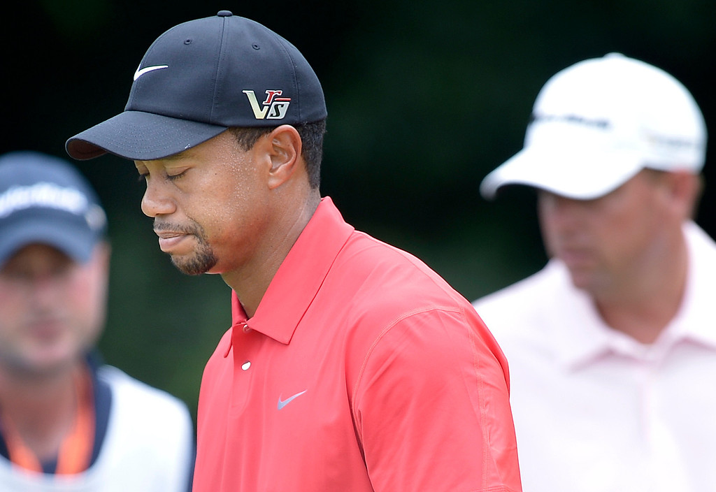 . US golfer Tiger Woods reacts after missing a putt on the 8th green during the final round of the US Open at Merion Golf Club on June 16, 2013 in Ardmore, Pennsylvania.    BRENDAN SMIALOWSKI/AFP/Getty Images