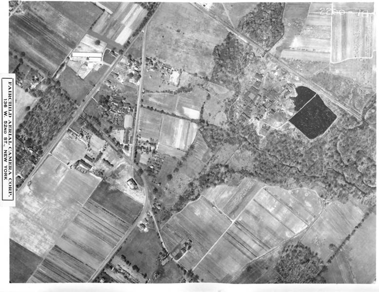 1923 aerial of Springfield showing Mountain Ave., South Springfield Rd., Milltown Rd. and where the present day Meisel Ave. is located. the big black object is  a pond that is where Meisel Field is today. The objects in the pond are believed to be large pieces of lumber being soaked in creosote for preservation.