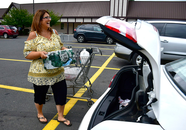 7/31/2019 Mike Orazzi | StaffrKristina Fuggetta of Pick Me Up LLC while shopping for a client in Bristol Wednesday.