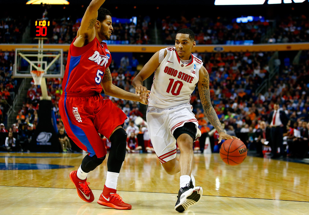 . LaQuinton Ross #10 of the Ohio State Buckeyes drives to the basket as Devin Oliver #5 of the Dayton Flyers defends during the second round of the 2014 NCAA Men\'s Basketball Tournament at the First Niagara Center on March 20, 2014 in Buffalo, New York.  (Photo by Jared Wickerham/Getty Images)
