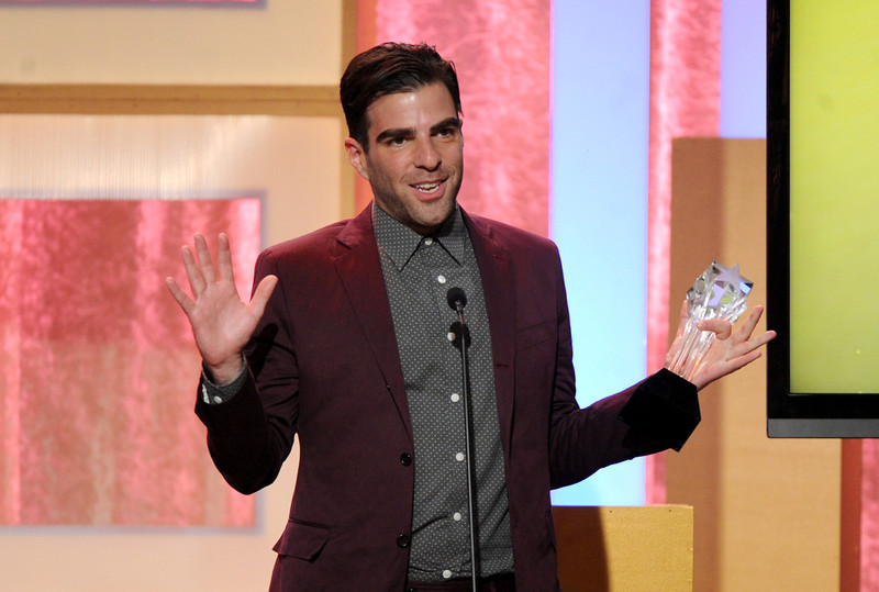 """. Zachary Quinto accepts award for best supporting actor in a movie or mini-series for \""""American Horror Story: Asylum\"""" at the Critics\' Choice Television Awards in the Beverly Hilton Hotel on Monday, June 10, 2013, in Beverly Hills, Calif. (Photo by Frank Micelotta/Invision/AP)"""
