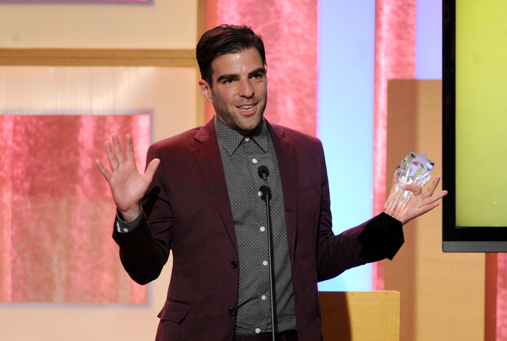 ". Zachary Quinto accepts award for best supporting actor in a movie or mini-series for ""American Horror Story: Asylum\"" at the Critics\' Choice Television Awards in the Beverly Hilton Hotel on Monday, June 10, 2013, in Beverly Hills, Calif. (Photo by Frank Micelotta/Invision/AP)"