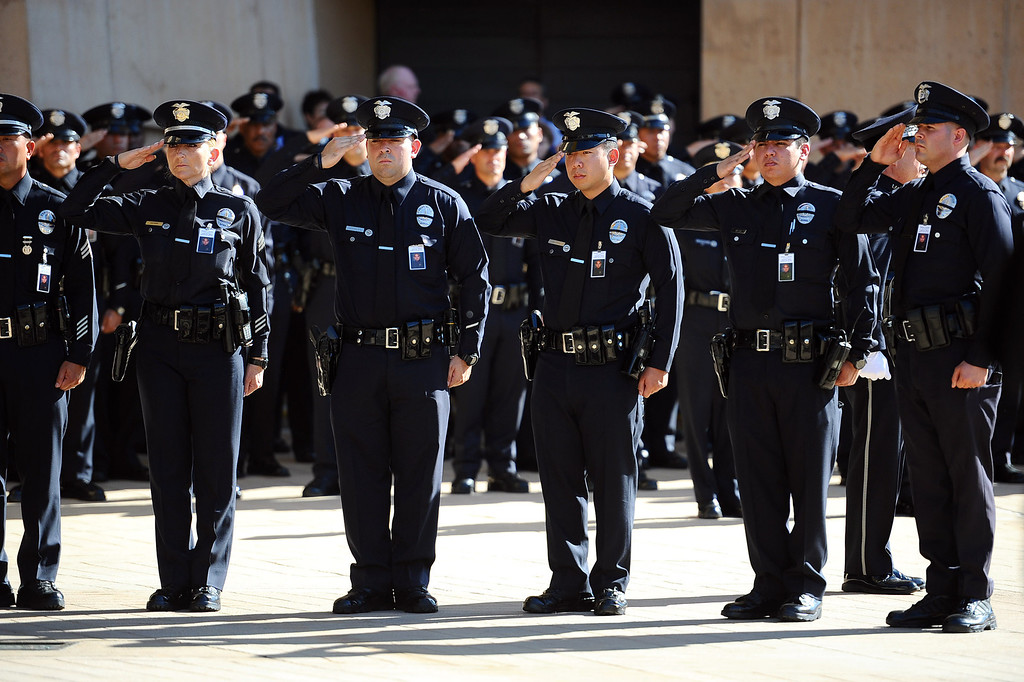 . Officers line up as pallbearers carry the casket of LAPD Officer Roberto Sanchez during his funeral at the Cathedral of Our Lady of the Angels in Los Angeles, CA May 14, 2014.  Sanchez was killed in a hit-and-run crash involving a SUV driver who is accused of deliberately ramming the officer\'s patrol car in Harbor City.(Andy Holzman/LA Daily News)