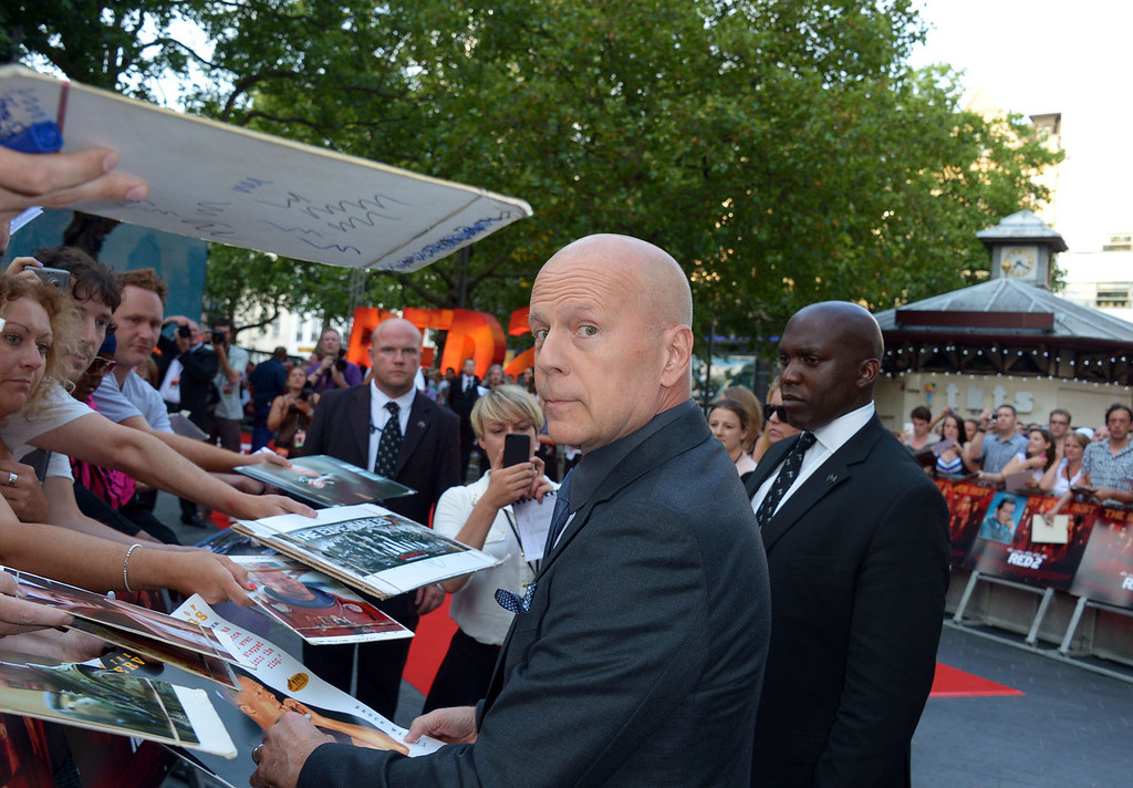 . Bruce Willis arrives at the European Premiere of Red 2, on Monday July 22, 2013 in London. (Photo by Jon Furniss/Invision/AP Images)