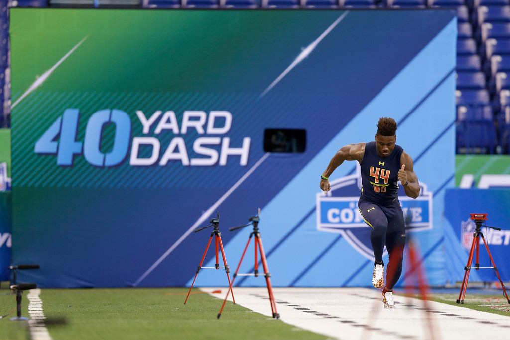 . Ohio State wide receiver Curtis Samuel runs the 40-yard dash at the NFL football scouting combine in Indianapolis, Saturday, March 4, 2017. (AP Photo/Michael Conroy)